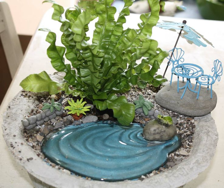 A container fairy garden in a home made papercrete planter with products from and - How to make a fairy garden container ...
