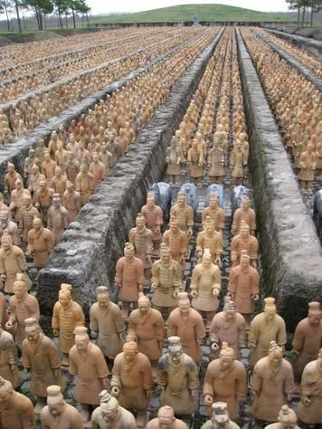 Terracotta Warriors in China...each one taken from a specific soldier, in a specific position in a company.  Each one-hand molded, fired, painted, armed with real weapons, placed in position, covered by roofing and meters of soil over the top.  Thousands of years later, after being lost in time, they still are awe inspiring, and beautiful.