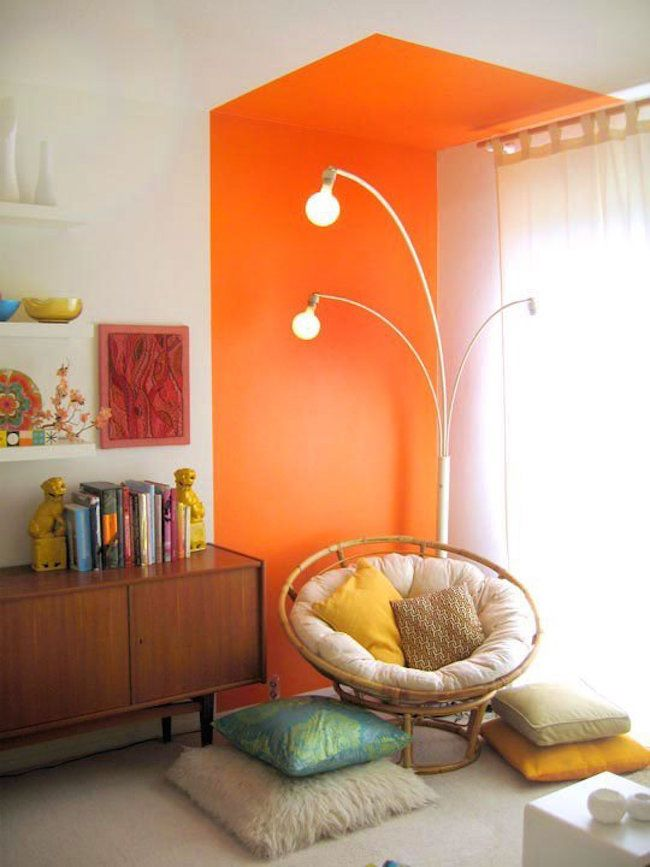 Bright orange reading nook that goes right up to the ceiling