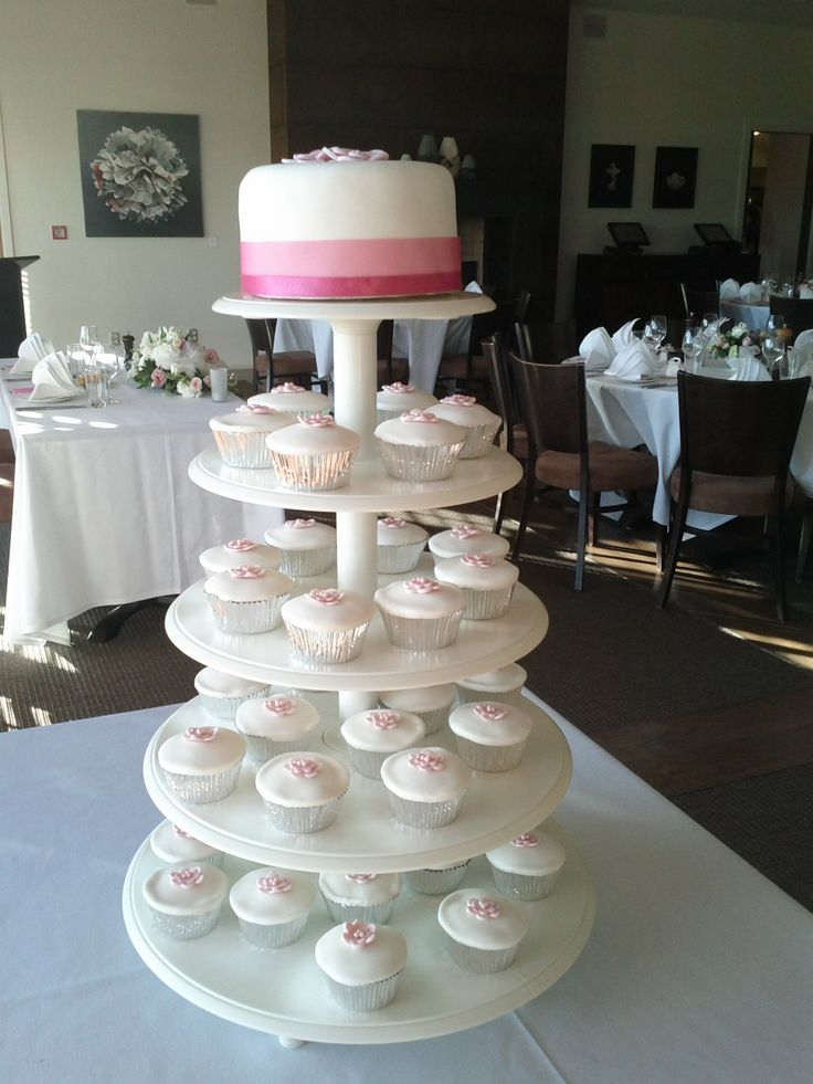 Traditional white, with not so traditional cupcakes below - this couple ensured they were still able to have a cake cutting ceremony with the single tier cake on top.