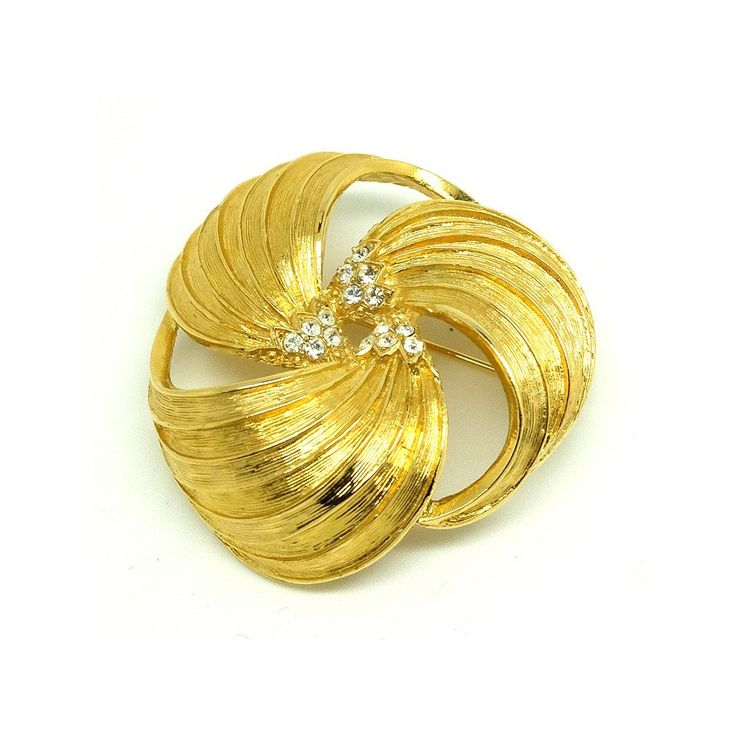 Vintage 1980s Givenchy gold plated round brooch. The piece is stamped 'Givenchy' on the back of the brooch.  ABOUT THE DESIGNER The House of Givenchy opened its doors in Paris 1952 by Hubert De Givenchy, the fashion capital of the world. It produced high quality costume jewellery throughout the 1950's and 1960's. These designs were simple and elegant with some pieces on a larger scale. Givenchy incorporated the use of gold plating, crystals and lucite in their designs.  MEAS...