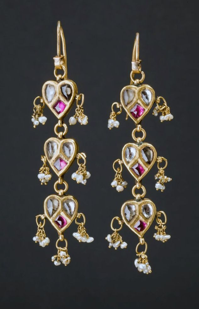 Northern India | Earrings; gold with rubies, white sapphires and baroque pearls | 1,100€ ~ Sold