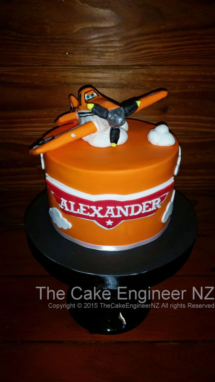 Dusty crophopper planes cake :) Topper is completely edible made from chocolate and modelling chocolate :)