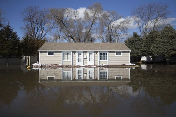 Deadly floods strike Nebraska as levees fail after bomb