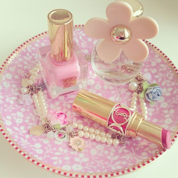 Pretty pink tray with girly things on it