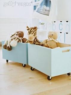 Cute Toy Storage: Teal wood boxes on wheels.