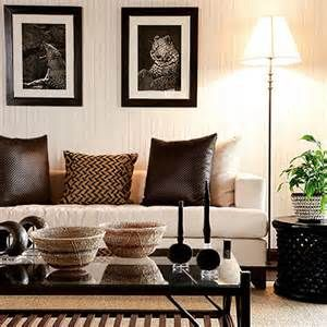 Beige and dark brown living room inspired by Africa with African details