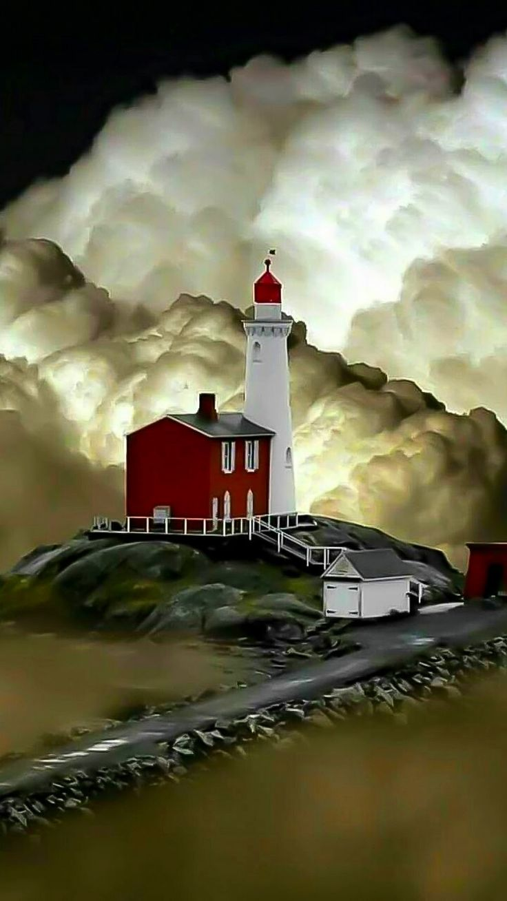 What a gorgeous photo of the clouds and the lighthouse!!