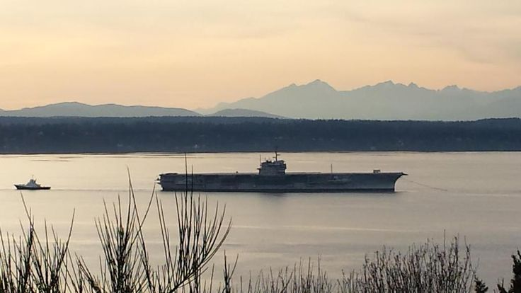 The mothballed aircraft carrier USS Ranger being towed through the Puget Sound Thursday on a long trip to a scrap yard in Texas. (Photo courtesy of viewer Fred Huston)
