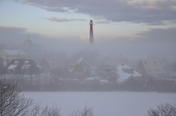 The light house in Den Helder rising out of the mist so proudly
