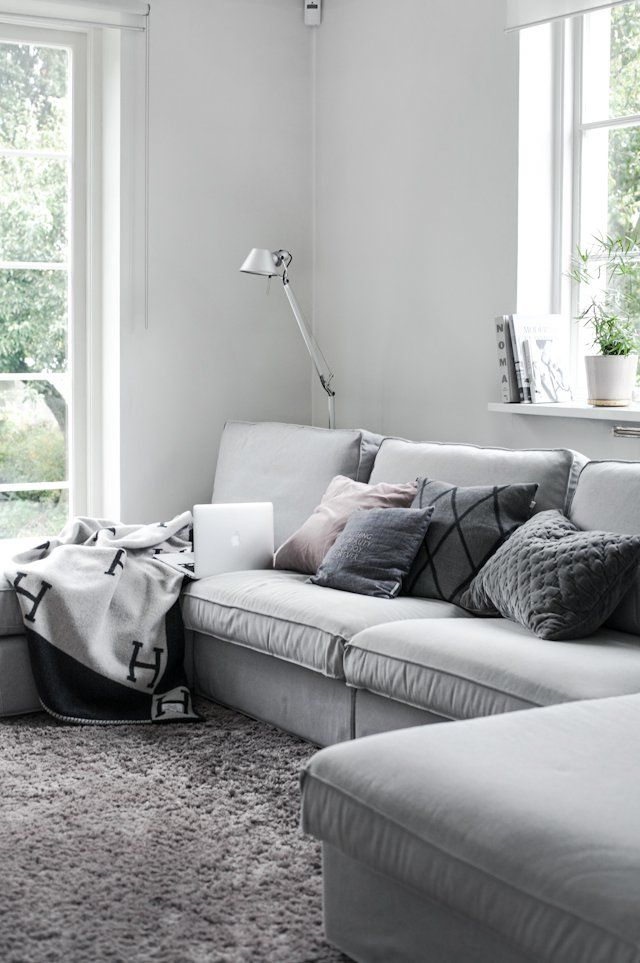 grey living room neutral sofa rug and white walls with big windows simple classy scandinavian feel