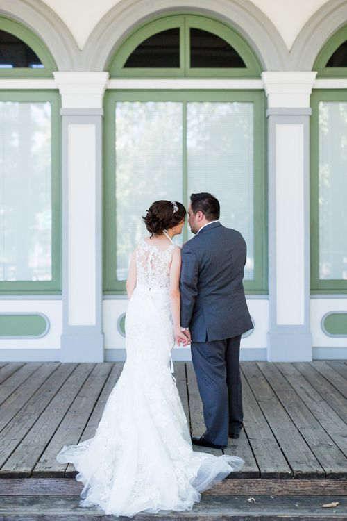 Bride and Groom From Behind Holding Hands | Firehouse-Restaurant-Wedding-Old-Town-Sacramento-Wedding-Photographer