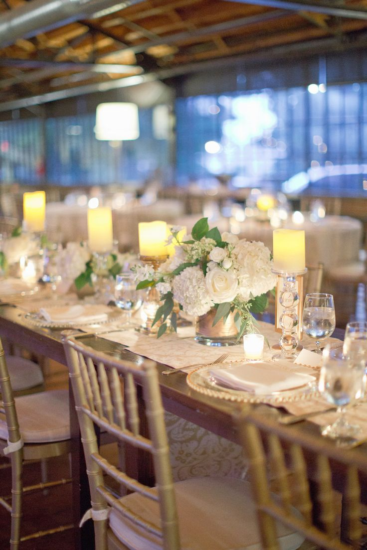 Wedding Tablescape: Hydrangeas & Candles & Gold Chiavari Chairs. Elegant! See more of the wedding here: http://www.StyleMePretty.com/2014/05/15/elegant-white-wedding-in-georgia/ HarwellPhotography.com - #SMP - Floral Design: ByTulip.com - Event Planning: ComeTogetherEvents.com