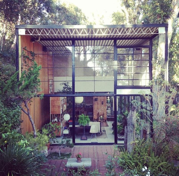 Classic combination of steel, clean lines, plants, and wood warmth...