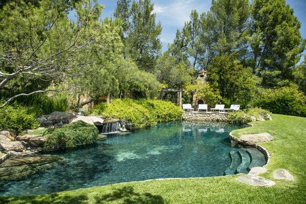 Natural Swim: Natural Swim Bordered by trees and grass, the pool effortlessly blends into the indigenous landscape.