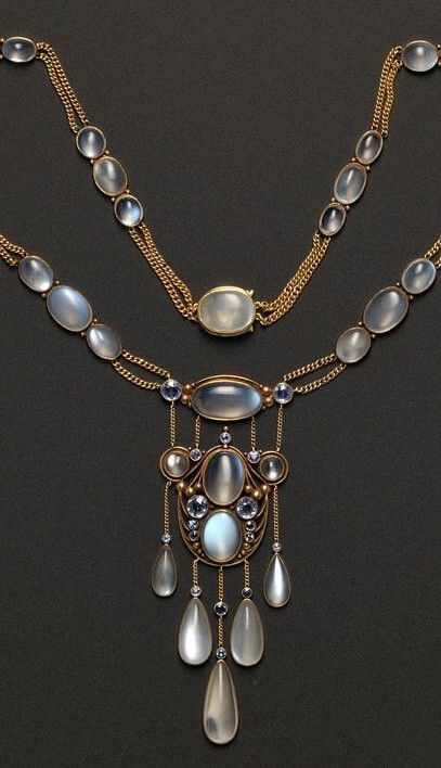 Arts and Crafts moonstone and sapphire pendant...Frank Gardner Hale.