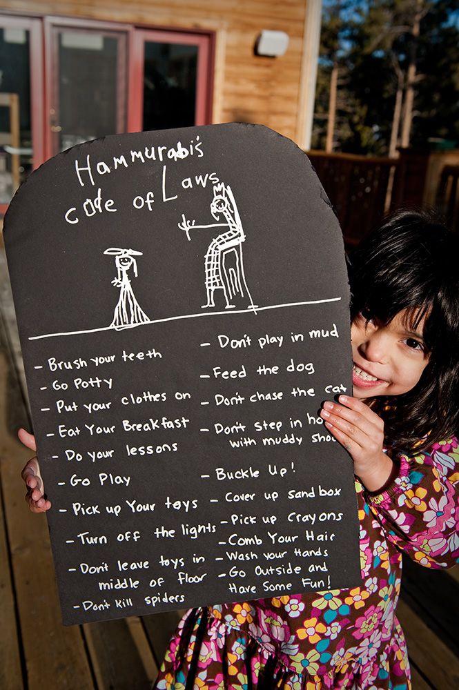 Your own laws (like Hammurabi's Code) inscribed with clalk on black cardboard steele