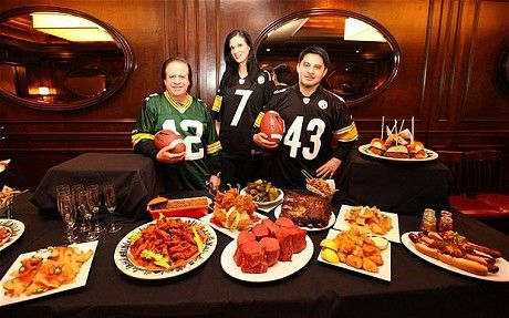 """""""A New York steak house is offering the world's most expensive buffet, costing £15000, in honour of Sunday's Super Bowl. The prize, offered by Manhatten's Old Homestead Steakhouse, includes Kobe beef burgers and hot dogs, sirloin steak covered in shavings of black truffles, and horse radish encrusted chicken wings topped with Beluga caviar, and will be cooked at the home of the winner by the restaurant's executive chef and his entire staff""""."""