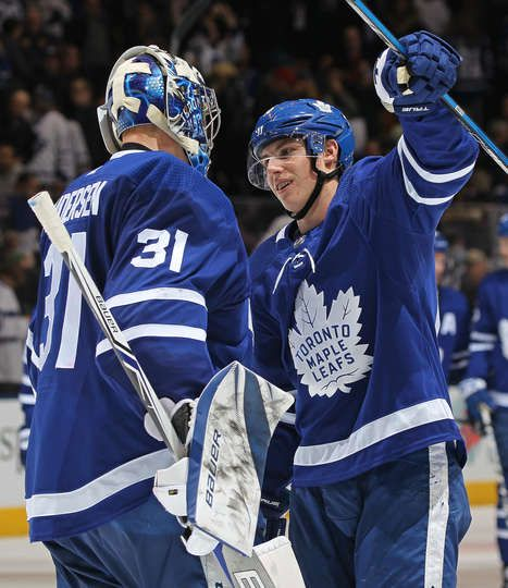 Mitchell Marner #16 of the Toronto Maple Leafs celebrates a career 5 point night with teammate Frederik Andersen #31 against the Ottawa Senators in an NHL game at the Air Canada Centre on February 10, 2018 in Toronto, Ontario, Canada. The Maple Leafs defeated the Senators 6-3.