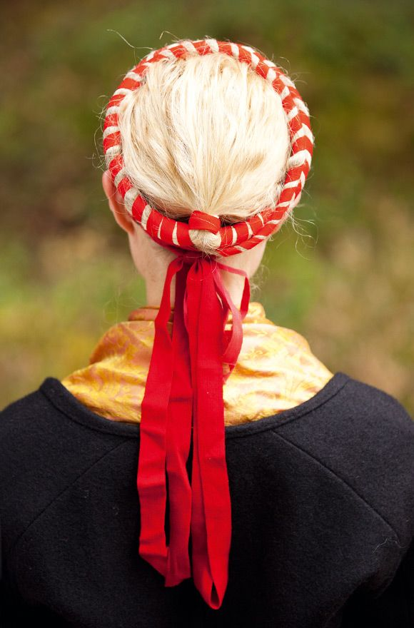 "The hair is tied up in an ""oppbindning"" - the decorative red ribbons hang loose over the back and shoulders. Norra Ny, Värmland."
