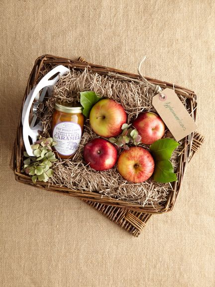 Would love to recreate these gorg fruit baskets for friends for Christmas...includes apples, caramel sauce, apple corer all nestled in a basket