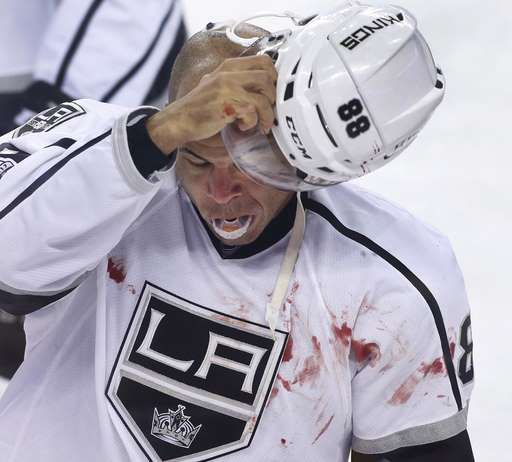 Iginla fights and scores, Kings beat Flames in chippy game  -  March 30, 2017:     Los Angeles Kings' Jarome Iginla goes to the penalty box after a fight with Calgary Flames' Deryk Engelland during the first period of an NHL hockey game in Calgary, Alberta, Wednesday, March 29, 2017. (Larry MacDougal/The Canadian Press via AP)