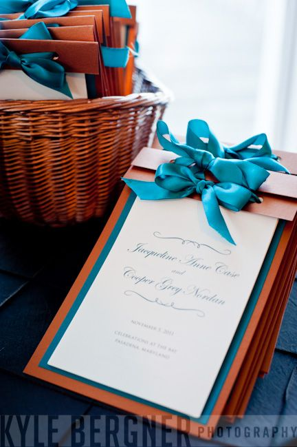 teal and copper ceremony programs/ change the copper to black and the teal to silver and it would match molly's wedding
