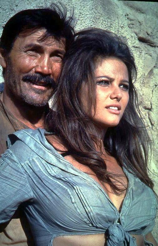 THE PROFESSIONALS (1965) - The wife (Claudia Cardinale) of an American businessman is kidnapped & taken into Mexico by bandit leader (Jack Palance) & his gang - Produced & Directed by Richard Brooks - Columbia Pictures - Publicity Still.