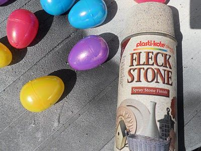 Faux eggs from plastic Easter eggs. Take plastic eggs and glue sides together (Goop works well.) Use a plastic primer spray to coat. Let dry. Base coat with a texture paint. (Rustoleum Hammer Finish also works.) Let dry. If you want other top colors, water down acrylic craft paint, put it in a spray bottle and spritz. Do this with several light coats, allowing to dry in between for best results.