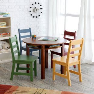 1 round Walnut table and 4 multi-colored chairs  Constructed from strong, natural beechwood  Under-table storage nook for books and toys  Table: 29 diam. x 23.5H inches  Chairs: 13.75W x 14.5D x 25.5H inches each  $215