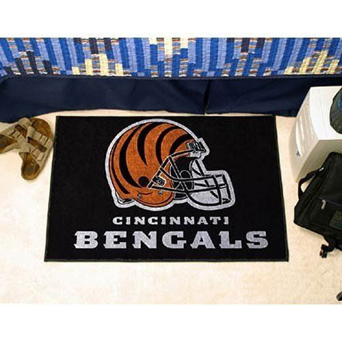 """Cincinnati Bengals 20""""x30"""" Starter Mat by Fanmats. $19.95. 16oz Carpet With Latex Back. Unisex Adults. Officially Licensed Cincinnati Bengals Door Mat Rug Doormat. 20 Inches x 30 Inches. Chrome Jet Printed For Full Color Penetration & Sewn Serged Edges. Cincinnati Bengals floor mat. This Bengals rug can serve as a door mat, or a floor rug. Measures 20 x 30 inches. Mat is chrome jet printed, allowing full penetration of the color down the entire tuft of the high luster nylon ..."""