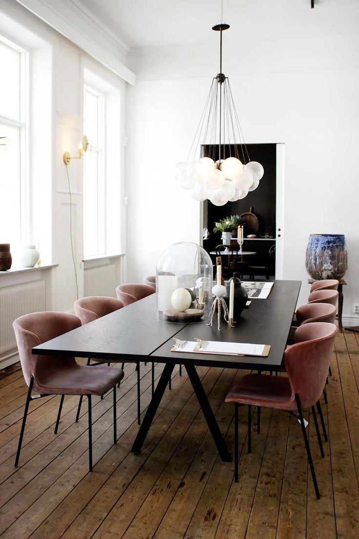 Modern European dining room with bubble chandelier