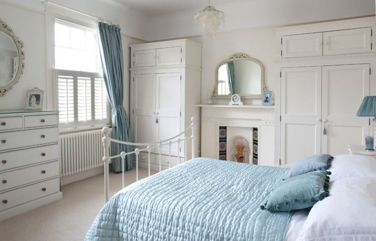 Cottage Bedroom With White Clothing Armoire Tips To Buying a Clothing Armoire