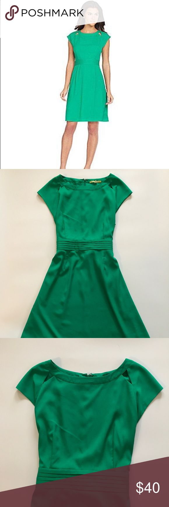"Gianni Bini Mona cut out dress Gorgeous Gianni Bini green Mona cut out dress in EUC. Measures 36"" in length, no holes or stains. Make an offer or bundle and save! Gianni Bini Dresses Midi"