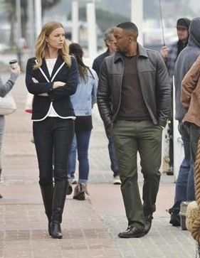 Revenge fashion: Emily Thorne in a nautical blazer, skinny jeans, and shin-high black leather boots