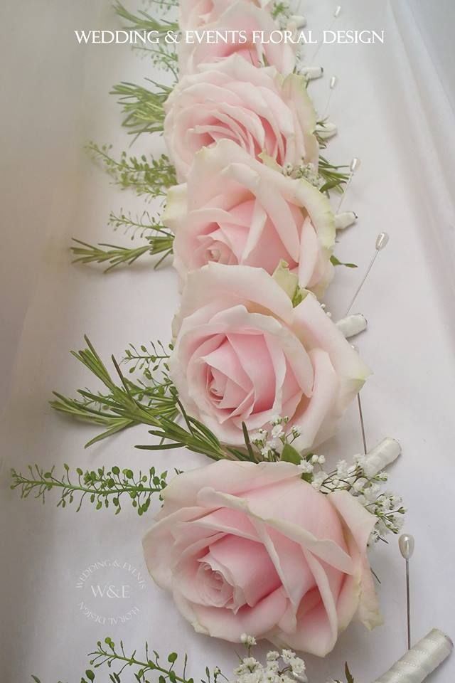 Sweet Avalanche Buttonholes designed by Wedding and Events Floral Design using Meijer Roses's flowers.