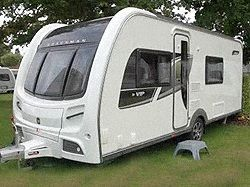 """New Coachman VIP 560 2013 Caravan,   Price: £22595.00 + Delivery Charges.  Berth: 4  Year: 2013.  Internal Length: 19ft.  External Length: 24ft 6"""".  Width: 7ft 7"""".  Unladen Weight:1490kg.  MTPLM: 1645kg."""