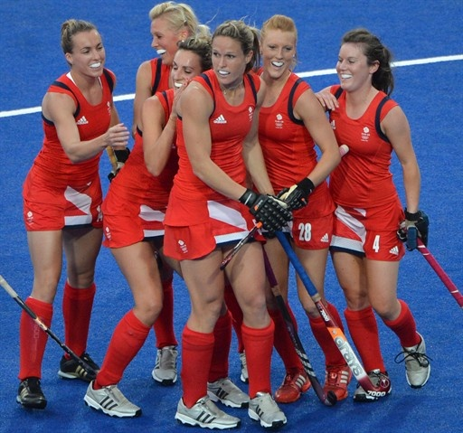 Crista Cullen (3R) of Britain celebrates along with teammates after scoring a goal against the Netherlands during the women's field hockey preliminary round match.