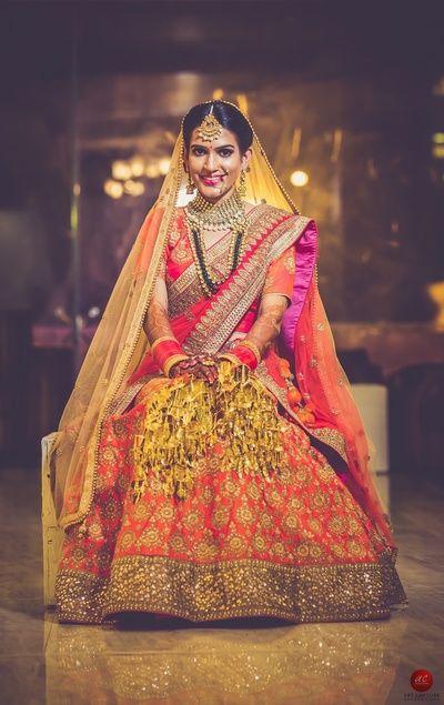 Bridal Lehenga - Red and Orange Bridal Lehenga   WedMeGood   Orange Lehenga with Gold Embroidery and Gold Border with a Red Choli and Double Net Dupatta  #wedmegood #indianbride #indianwedding #gold #orange #kaleere #lehenga #bridal #indianlehenga