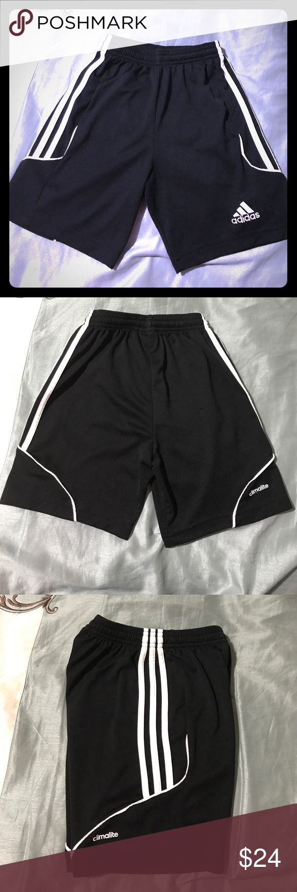 Adidas Soccer Shorts ⚽️ w/bonus shorts Black and white Adidas soccer shorts with climate technology. Have been used by both my daughter and son and still have plenty of use to them. Have included bonus soccer shorts in a size small. Both shorts display slight thread pulling as shown in pictures. adidas Bottoms Shorts