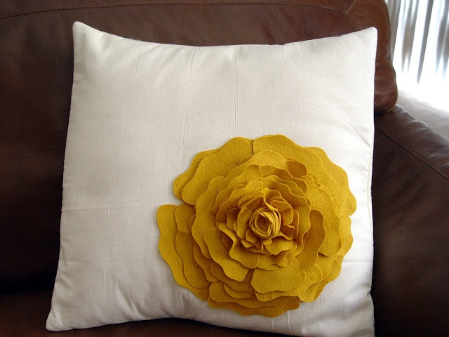 Rose Pillow that I love... take the instructions from the barrette and turn it into the pillow...just keep enlarging the outer petals....I'm going to make mine out of fleece.