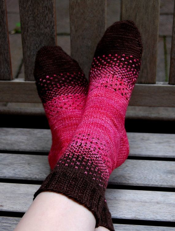 "~~ This listing is for a PDF PATTERN of the socks pictured. ~~  This sock pattern provides a great introduction to stranded knitting. My Mom and I shared two skeins of Malabrigo sock yarn and challenged each other to create a unique two-color design. This is when the idea for my 'There & Back Again' sock design was born. Try different color combinations to create your own distinctive transitions!  Size: S (M, L) 7.5"" (9"", 10.5"") foot circumference.  Yarns: MC: Malabrigo Yarn Sock (100%…"