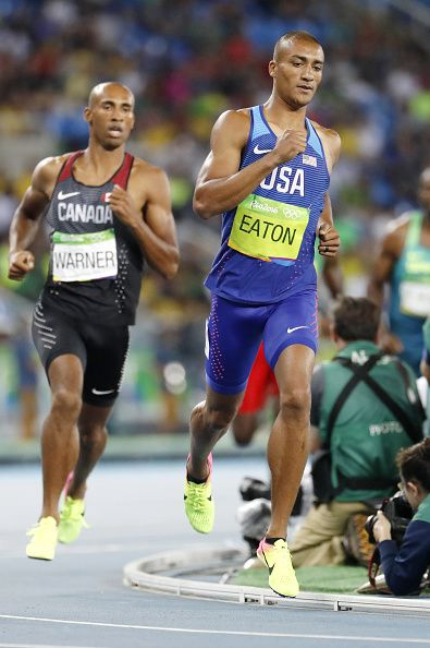 Ashton Eaton of the United States and Canada's Damian Warner compete during the…