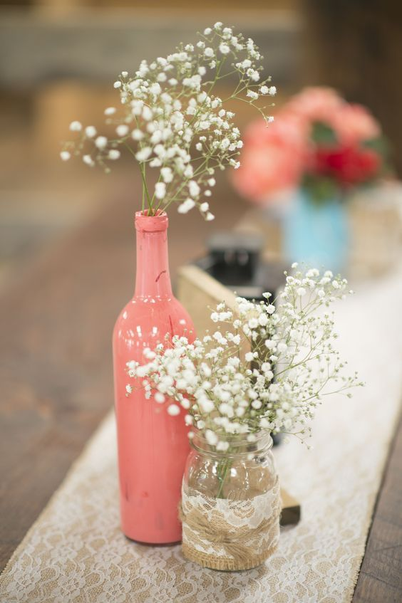 rustic coral bottle and lace wedding centerpiece / http://www.deerpearlflowers.com/unique-wedding-centerpiece-ideas/
