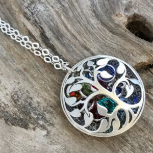 Give her a special personalized message this year. She has always been there for you, let her know you appreciate her support. This locket is cupped and domed, then fitted to create a beautiful Tree of Life Locket filled with birthstones. Birthstones can be seen through cutouts from tree. ♥ List