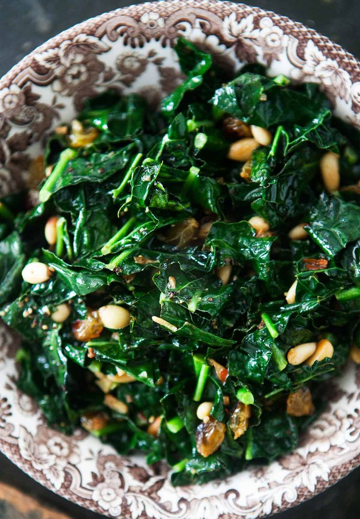Sautéed Greens with Pine Nuts and Raisins ~ Sautéed kale, mustard, turnip, beet or collard greens, tossed with toasted pine nuts, golden raisins, a little red pepper and black pepper. Sicilian-style greens. ~ SimplyRecipes.com