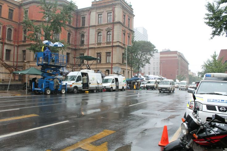 Camera crews set up in front of North Gauteng High Court
