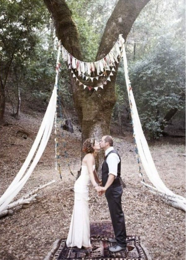 Bunting Wedding Arbor. also love the details on this dress!