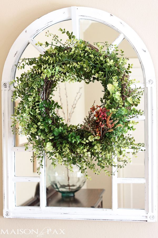 Making it was a snap. Here is what I used: 20″ grapevine wreath 2 large bunches of fake dk color eucalyptus 2 small bunches of fake  lt color eucalyptus wire cutters floral wire (ok, so I actually used one small trash bag tie… but you can be more professional and use floral wire  ) all on sale for $20