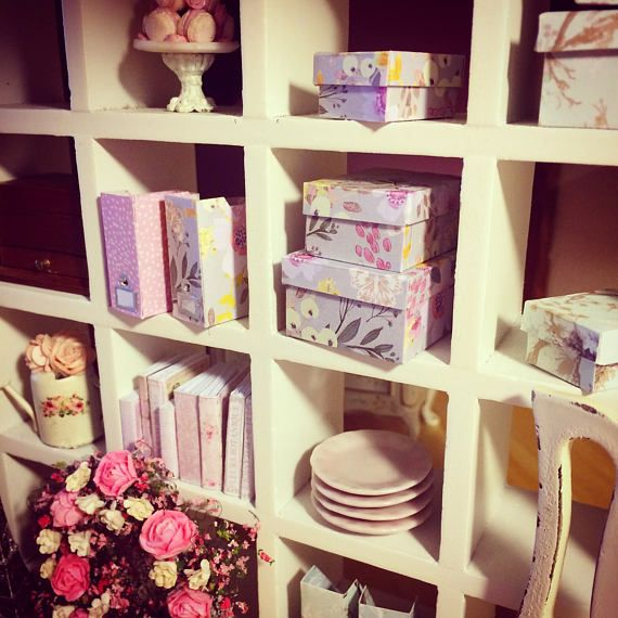 Pretty 1:12 scale rectangular storage boxes, magazine files (folder and document organisers), ring binder folders and envelopes. From my Feminine Touches collection, they are unique and handmade with premium card.  Double sided card, one side floral and the other pink with white dots. Perfect for any modern dollhouse, with the added bonus of being lovely decorations also.  Can be purchased as a whole set or as separate items, as laid out below.  WHOLE SET (includes 3 boxes, 2 magazine…
